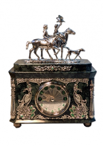 s-230. <br>  Clock «Hunting with eagle and dog». <br>  Silver 925 test. 498 grams. Natural Jasper. Carnelian and Chrysoprase.  Enamel. Height 22 cm.